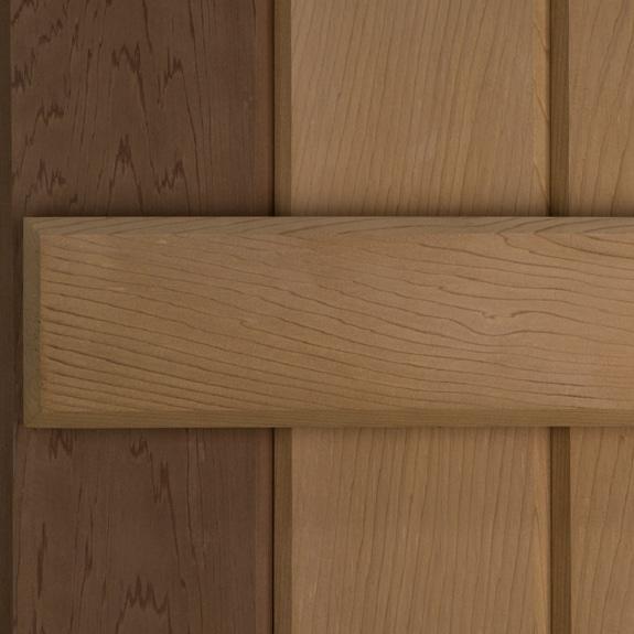 Exterior board and batten western red cedar outdoor shutters.