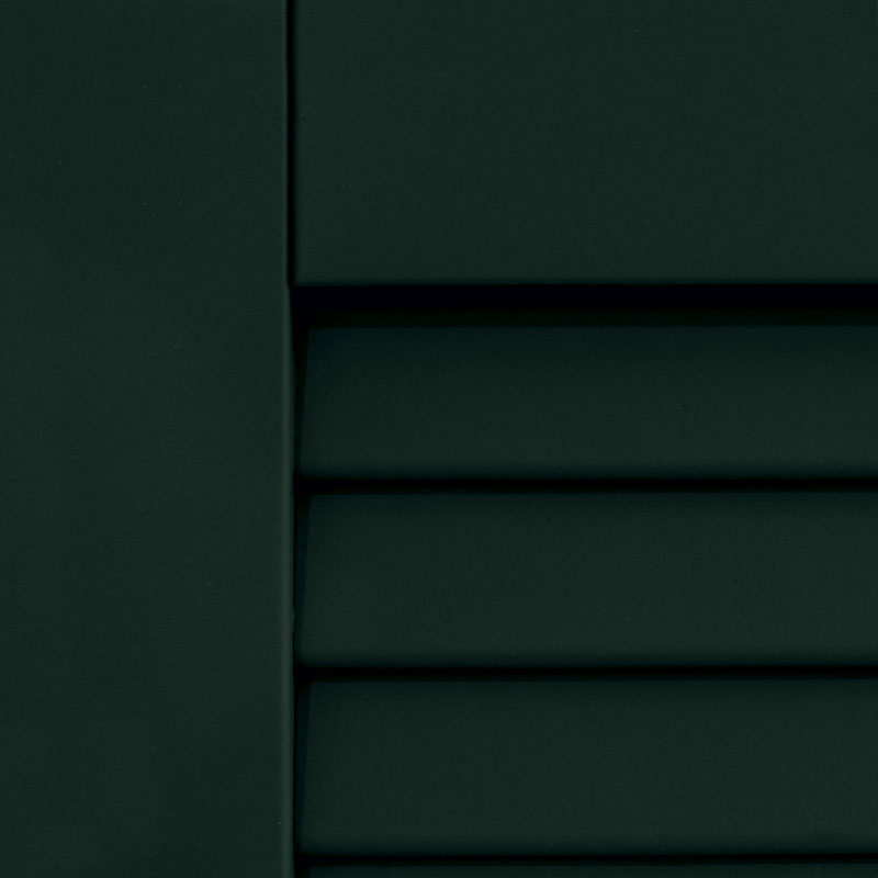 Dark green shutters painted for an exterior house.