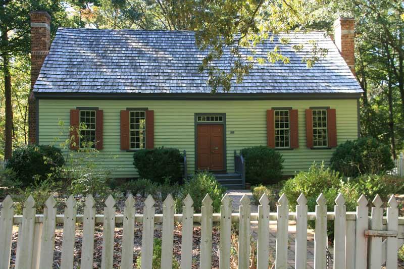 Exterior shutter styles shown on a historic plantation-plain house.