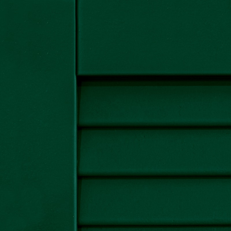 Outside painted green shutters for houses.