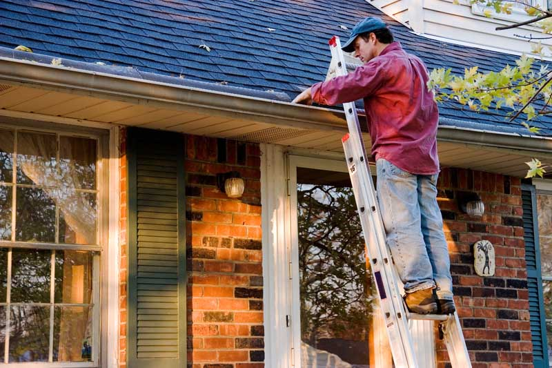 Cleaning gutters is part of exterior home maintenance