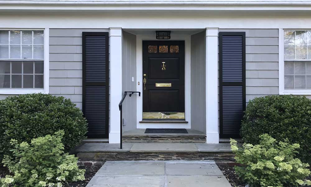 Tall front door exterior wood shutters for the outside entry.