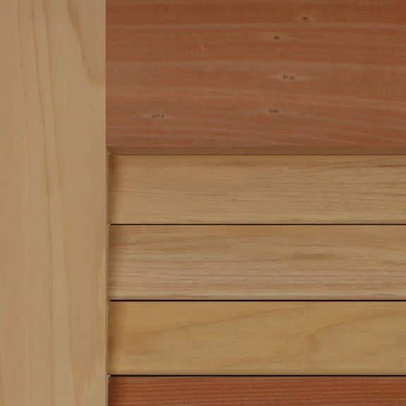 Cedar exterior wood shutters with natural grain louvers.