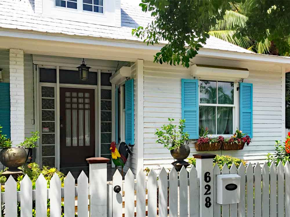Colorful turquoise key west exterior shutters.