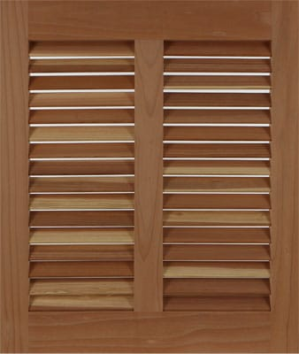Cedar exterior bahama shutter to cover house windows.