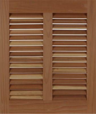 Cedar exterior bahama shutter to cover house windows.
