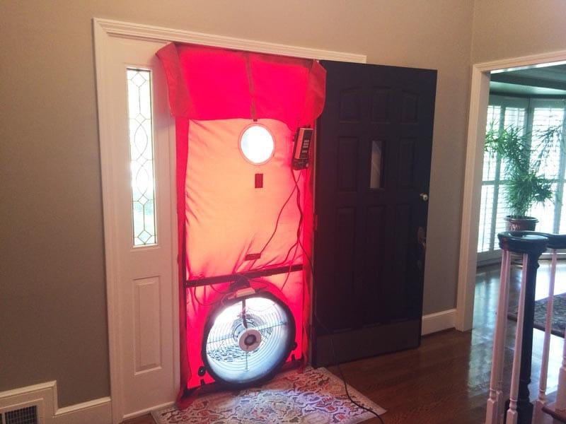 Blower door test to audit air leaks.