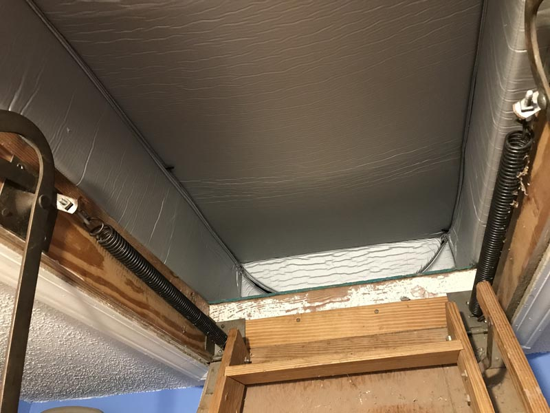 Insulate attic stairs with a tent cover.