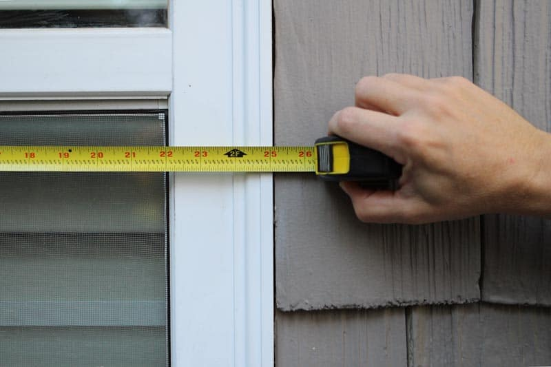 Measure windows for exterior vinyl shutters.