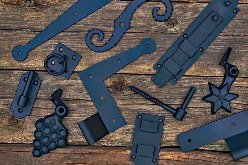Exterior shutter hardware including hinges, dogs, and bolts.