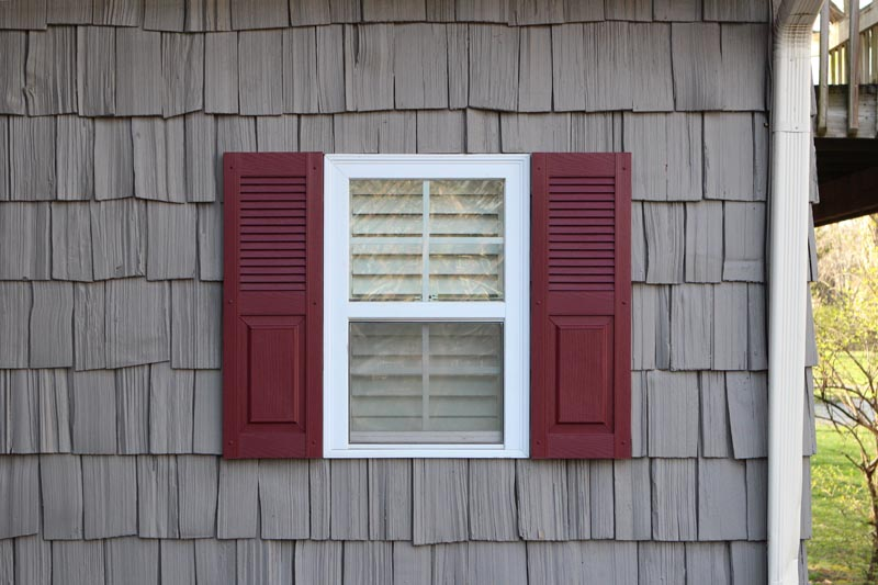 Exterior vinyl shutters combination style installed.